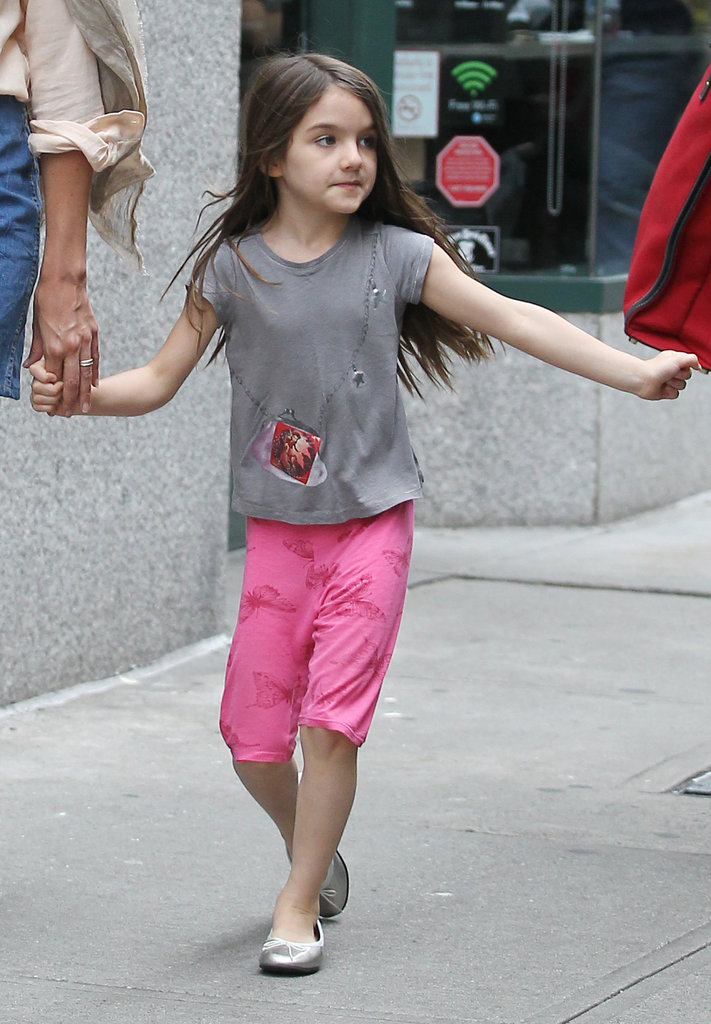 Suri Cruise skipped through the NYC streets in pink pants and flats.