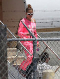 Jennifer Lopez wore a bright pink outfit getting off of the plane in LA.