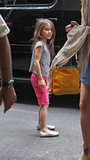 Suri Cruise looked adorable in pink as she hung out with her mom in NYC.