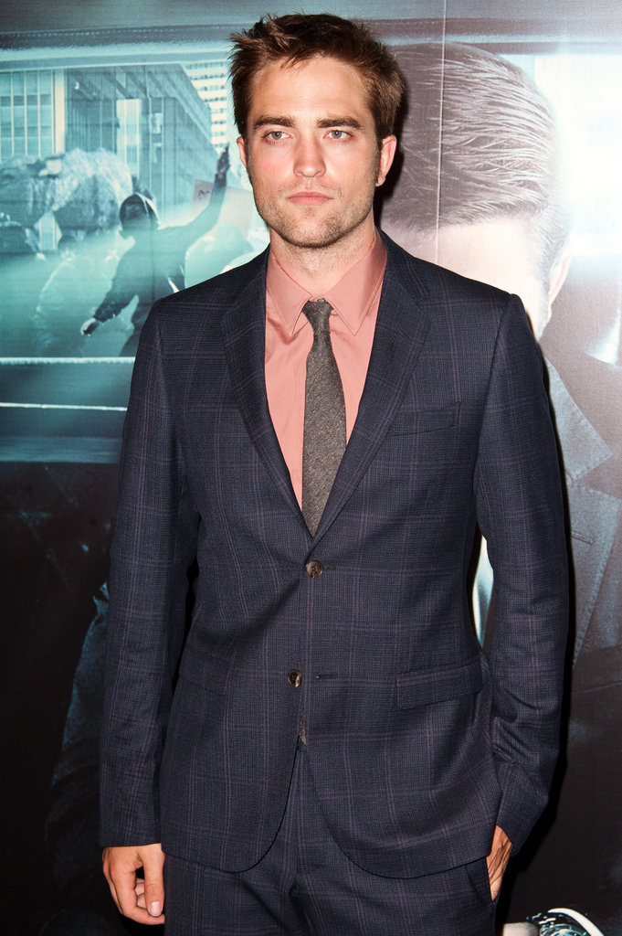 Robert Pattinson tucked his hand in his pocket while walking the red carpet.