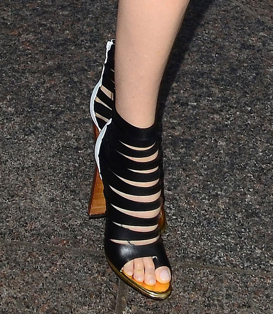 Charlize Theron's caged Christian Louboutin sandals had just enough drama to offset her classic black sheath.