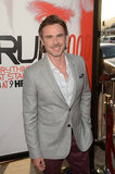Sam Trammell smiled as he arrived at the premiere in Hollywood.