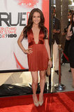 Camilla Luddington lit up the carpet in a short orange dress.