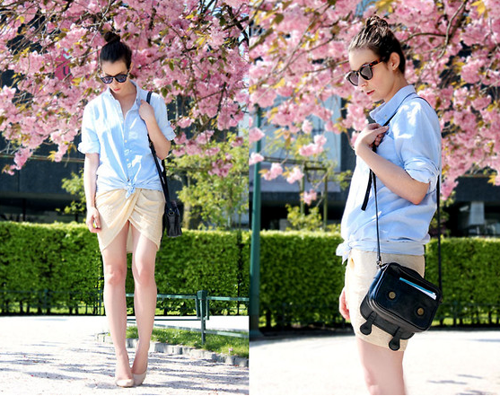 Anchor a flirty skirt with a classic oxford for office hours and beyond.  Photo courtesy of Lookbook.nu