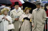 Queen Elizabeth II, her mother, and Prince Philip were ready to brave the elements in 1990.