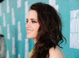 Kristen Stewart wore her hair long and curled at the show.