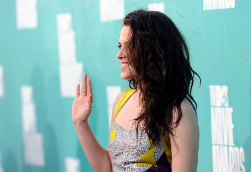Kristen Stewart wore her hair down and curly.