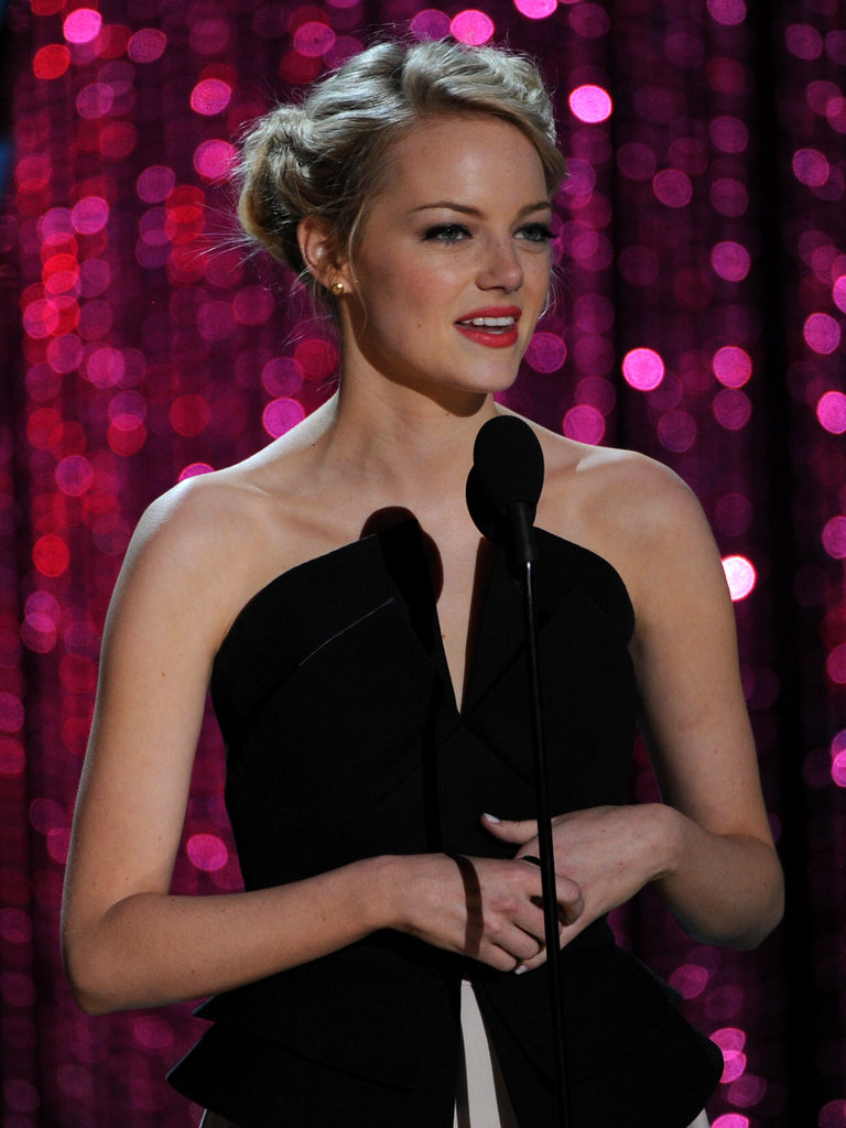 Emma Stone wore her hair up at the show.