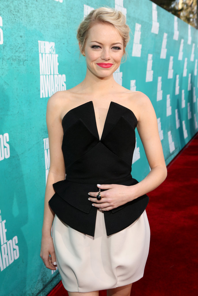 Emma Stone wore a black and white dress to the MTV Movie Awards.