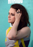 Kristen Stewart ran her fingers through her hair on the red carpet at the MTV Movie Awards.