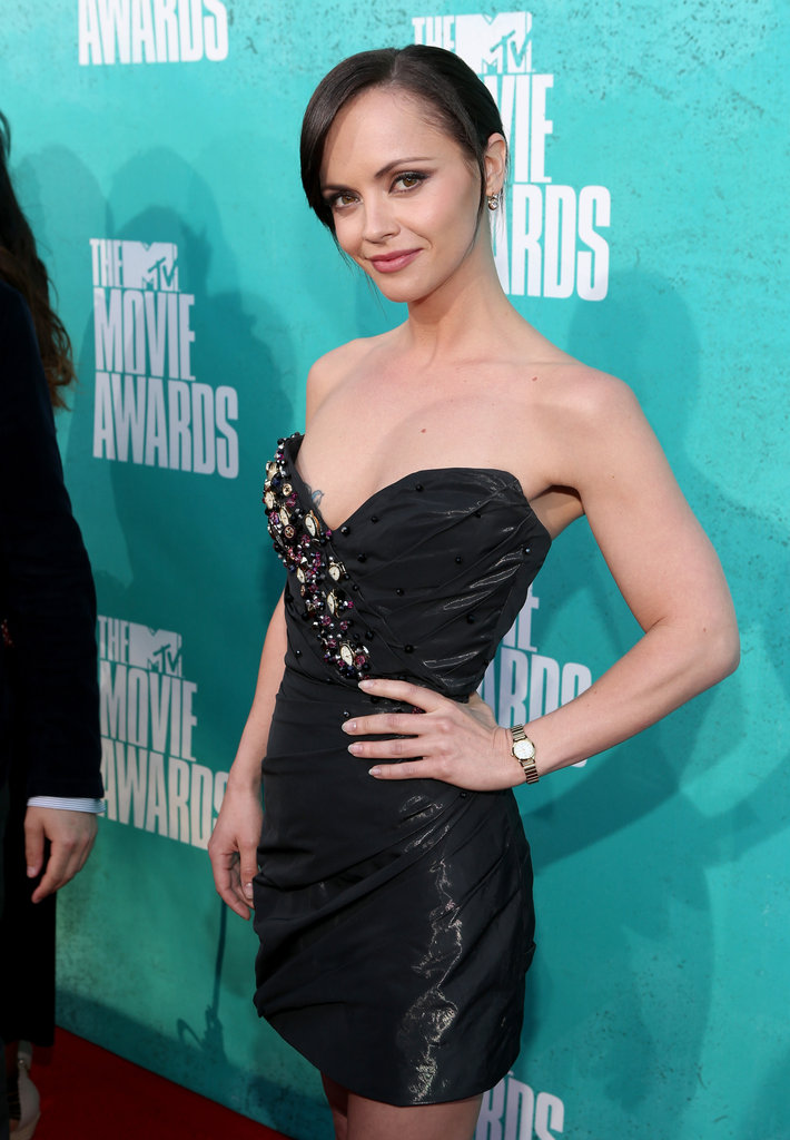 Christina Ricci wore a black mini dress to the show.