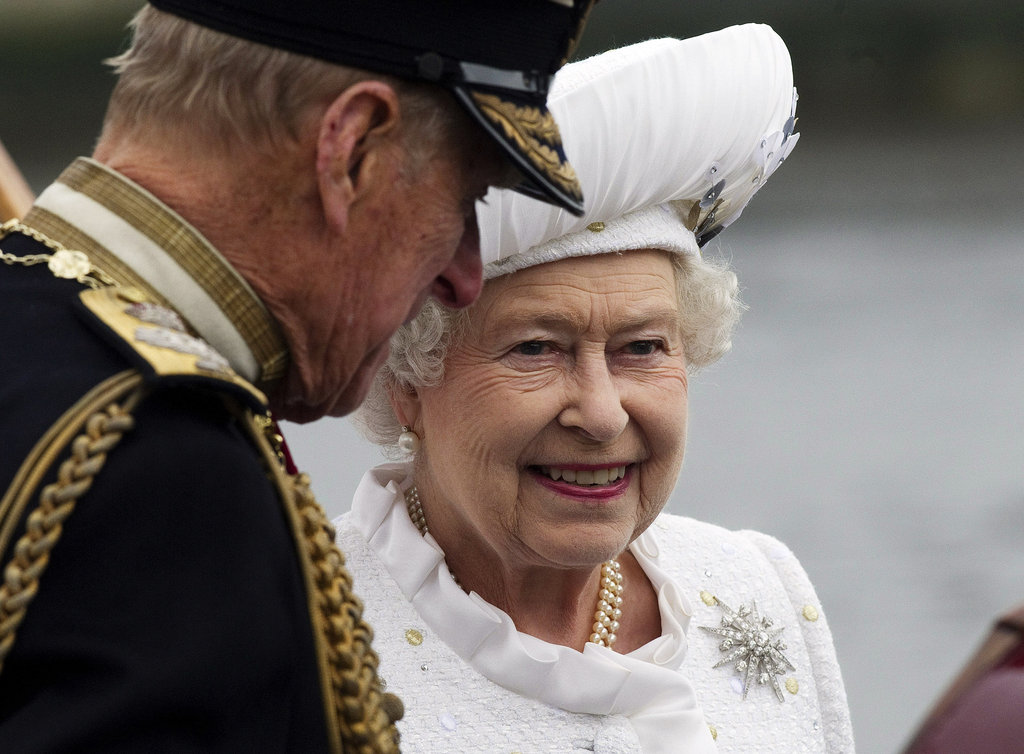 The queen smiled with her husband, Prince Philip.