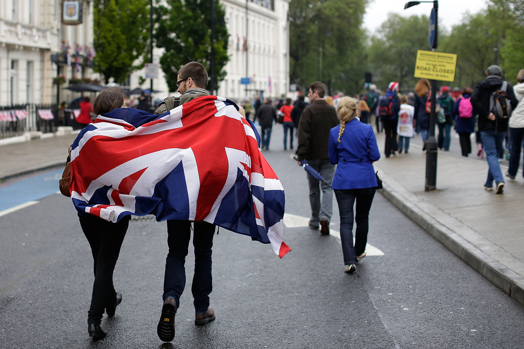 A couple draped a Union Jack over themselves.