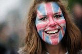 A woman wore Union Jack face-paint.