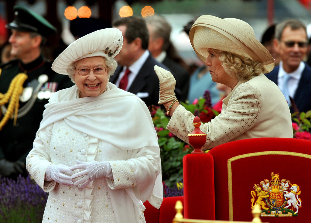 Camilla waved beside the queen.