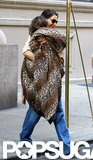 Suri Cruise was wrapped in a leopard blanket with mom Katie Holmes leaving their apartment in NYC.