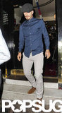 David Beckham wore a blue button-down and a black cap for a night out on the town in London.