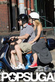 Olivia Wilde held on tight to boyfriend Jason Sudeikis as they drove around NYC.
