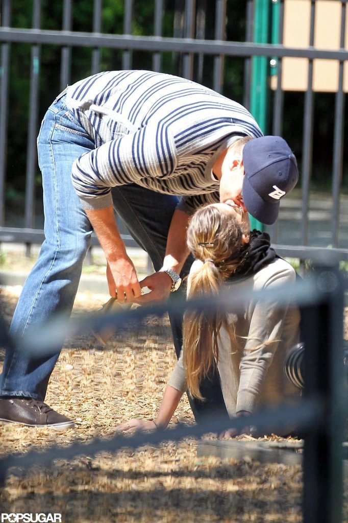 Tom Brady and Gisele Bundchen kissed in the sandbox.
