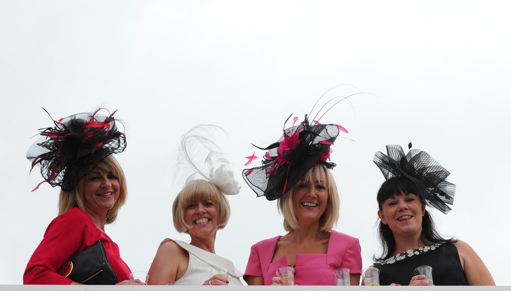 Ladies showed off their frilly hats.