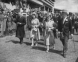 King George VI, Princess Elizabeth and Queen Elizabeth walked through the grounds at The Oaks in June 1948.