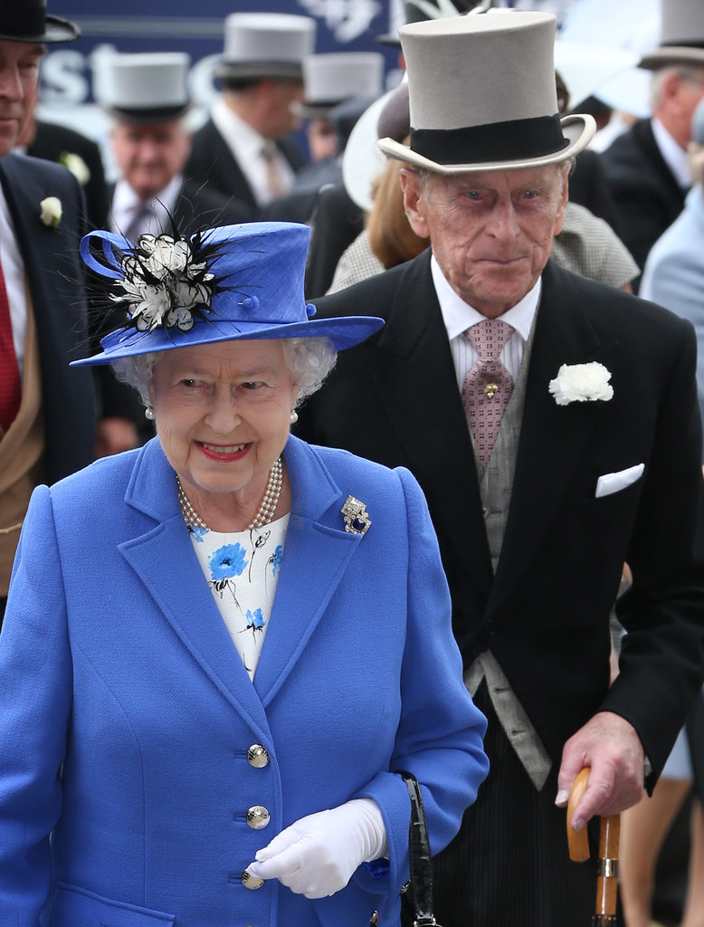 The queen is accompanied by her husband at the derby.