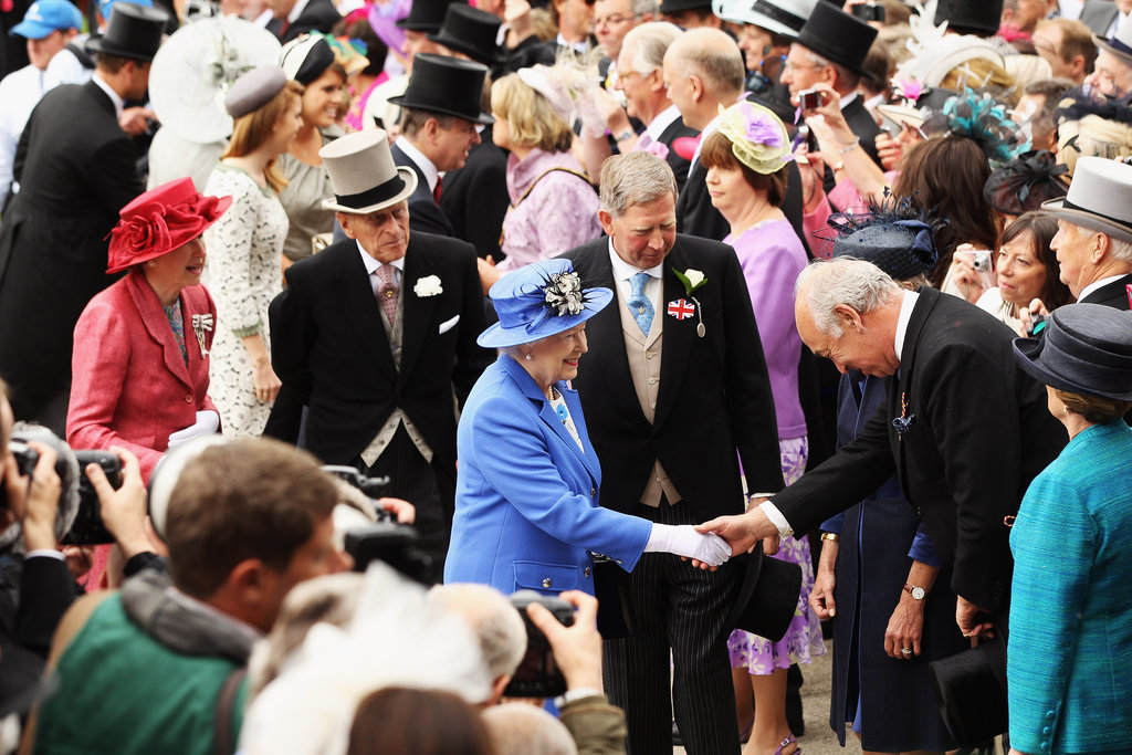 The queen greeted a racegoer during the Diamond Jubilee Derby.