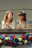 Princesses Beatrice and Eugenie of York chat at the Diamond Jubilee Derby.