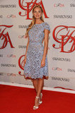 Candice Swanepoel looked sweet and girlie in a pale-blue lace Valentino frock and white heels.