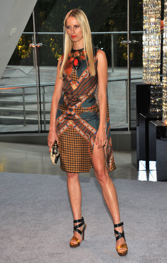 Karolína Kurková stunned in a printed dress and ankle-strap wedges.