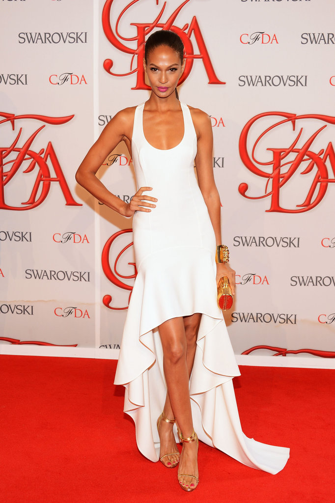 Joan Smalls wore a sexy, minimalist white gown, courtesy of her date for the night, Michael Kors, at this year's CFDA Fashion Awards.