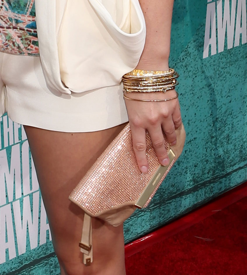 Leighton Meester accented her ensemble with an armful of gold bangles and a glittering Jimmy Choo clutch.