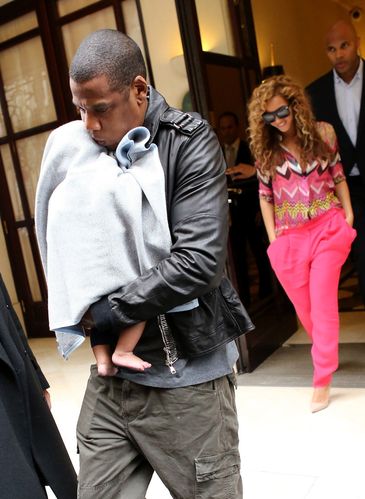 Jay-Z carried baby Blue out of their hotel in Paris while mom Beyoncé followed close behind.