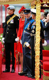 Kate was a lady in red between Prince Harry and Prince William in their uniforms.