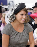 Princess Eugenie wore a navy hat with striped ribbon.