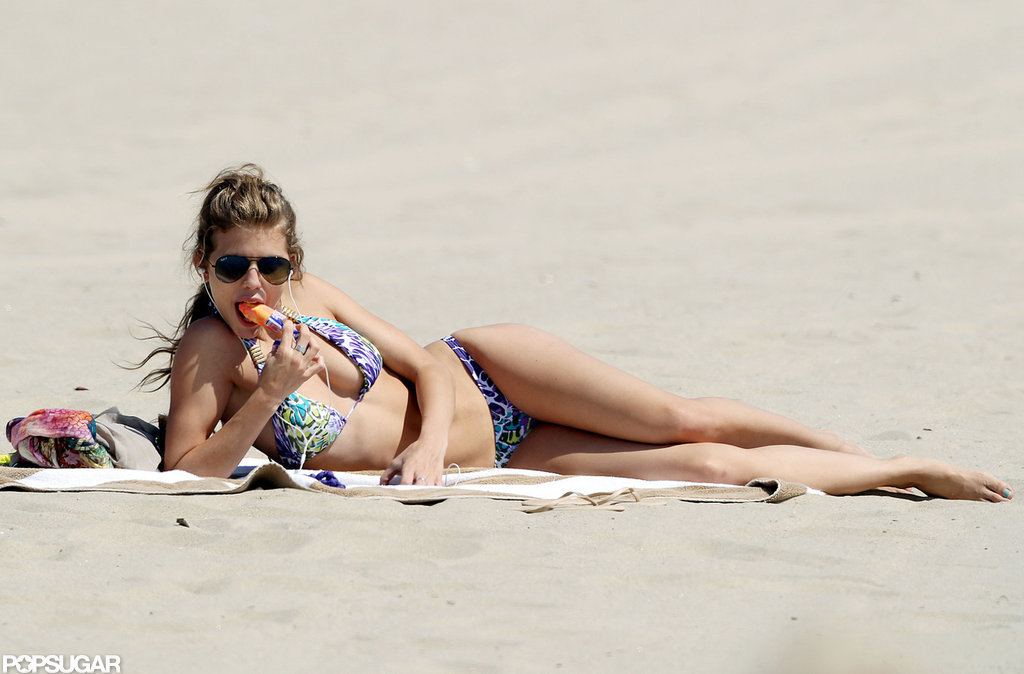 AnnaLynne McCord lounged on the beach while eating a Popsicle.