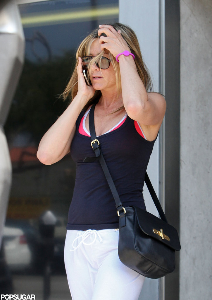 Jennifer Aniston talked on the phone post-workout.