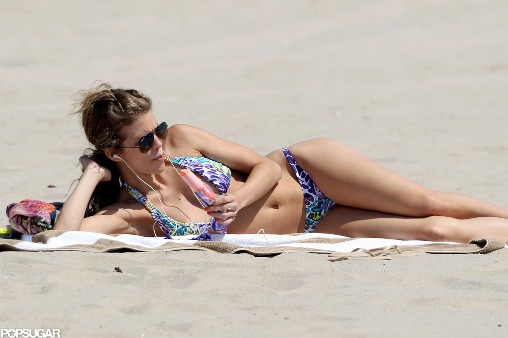 AnnaLynne McCord cooled down with a Popsicle on the beach in LA.