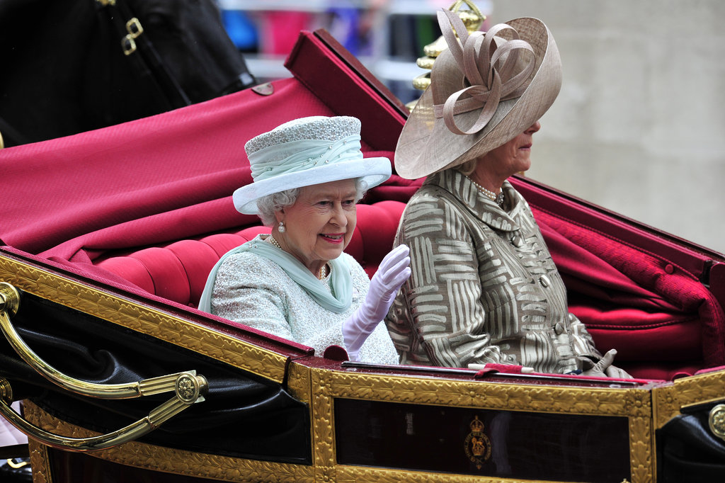 The queen waved on her way to Buckingham Palace.