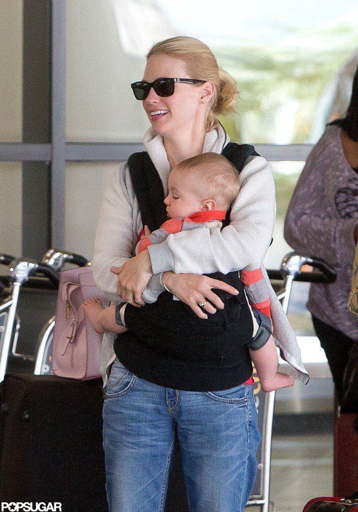 January Jones smiled at LAX while holding baby Xander.