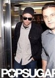 Robert Pattinson arrived at LAX wearing a black hat and sunglasses.