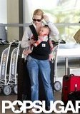 January Jones looked at her phone while holding Xander at LAX.