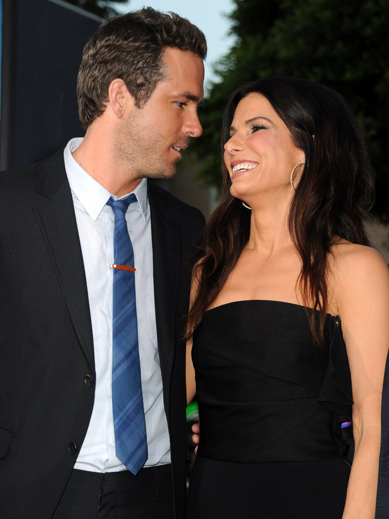 Ryan Reynolds and Sandra Bullock were introduced by a mutual friend years ago and formed a strong friendship on the set of 2009's The Proposal. They supported each other through divorces, his from Scarlett Johansson and hers from Jesse James. Ryan's even close with Sandra's little one, Louis.