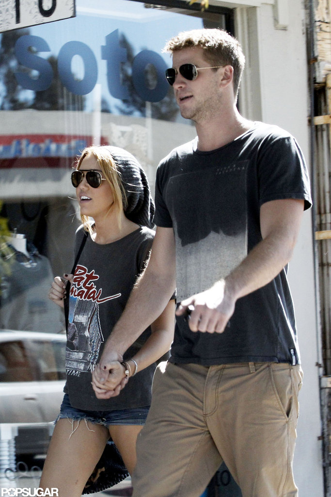 Miley Cyrus and Liam Hemsworth held hands as they shopped around LA in August 2011.
