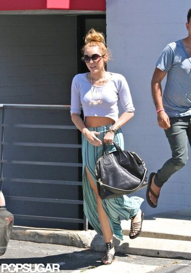 Miley Cyrus pictured wearing her Neil Lane engagement ring.