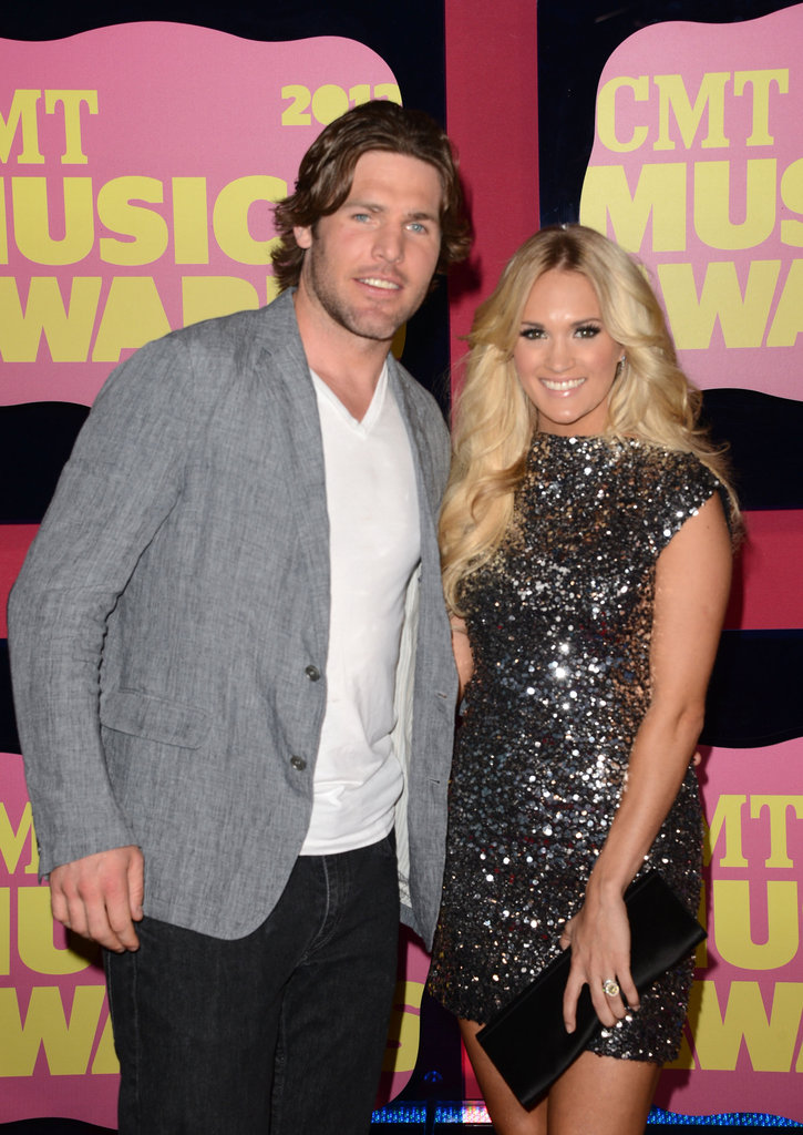 Carrie Underwood wore a sequined Randi Rahm dress and was accompanied by husband Mike Fisher to the CMT Music Awards.
