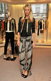 Poppy Delevingne dressed up this tie-dye (and side-slit infused) pair of pants with a cool cocktail jacket and sleek gold-accented accessories.
