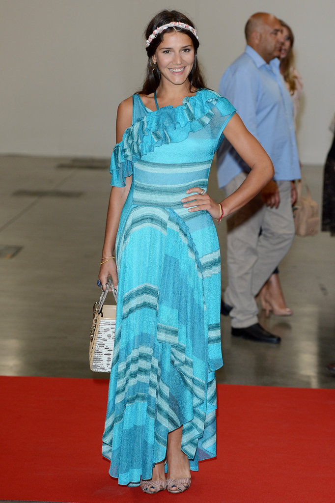 Margherita wore this Missoni ruffled knit dress ($2,534) to an event in Italy in June 2012. Her accessories included a beaded headband, straw bag, and striped sandals. For something a little less pricey, try this Sequin Hearts ruffled striped maxi dress ($59).