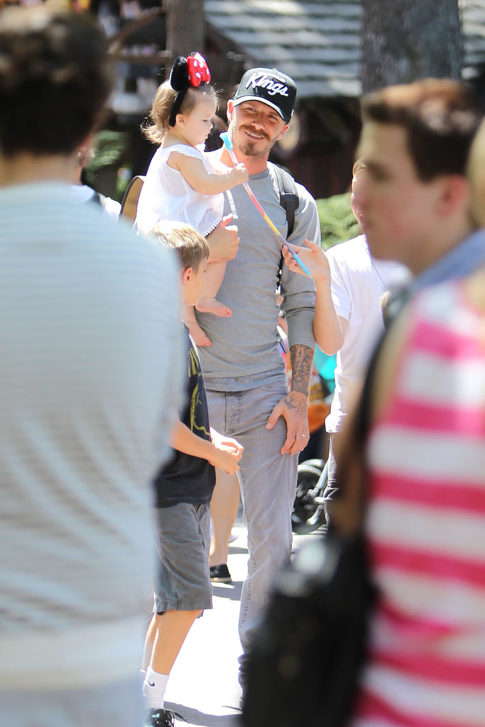Harper Beckham had fun with dad David Beckham at Disneyland.