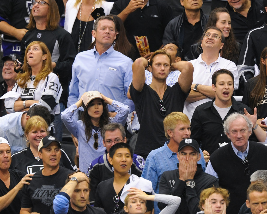 Alexander Skarsgard and Ellen Page looked perplexed at the LA Kings Stanley Cup finals game in LA.